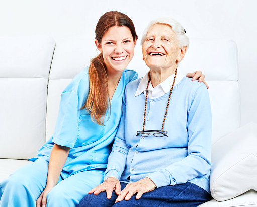old women and a caregiver smiling