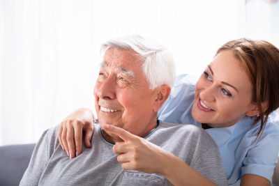 caregiver pointing at something to senior man